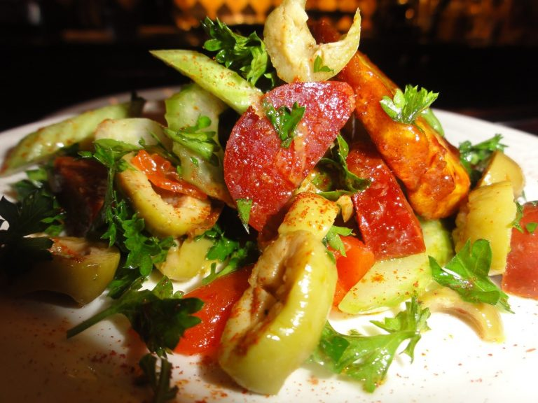 caramelized plantains with spanish green olive chorizo salad